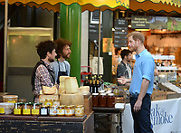15 June 2017 - Prince Harry tours stalls during a visit to Borough Market in London which has opened yesterday for the first time since the London Bridge terrorist attack. Photo Credit: ALPR/AdMedia