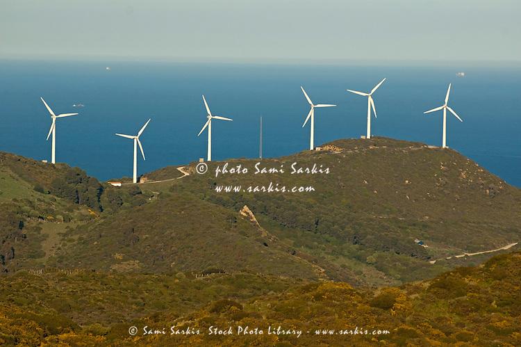 Wind turbines on cliff above sea, Tarifa, Andalusia, Spain.