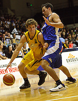 John Leasure drives past Saints guard Troy McLean during the National basketball league match between the Wellington Saints  and Taranaki Mountainairs at TSB Bank Arena, Wellington, New Zealand onFriday, 9 April 2010. Photo: Dave Lintott / lintottphoto.co.nz