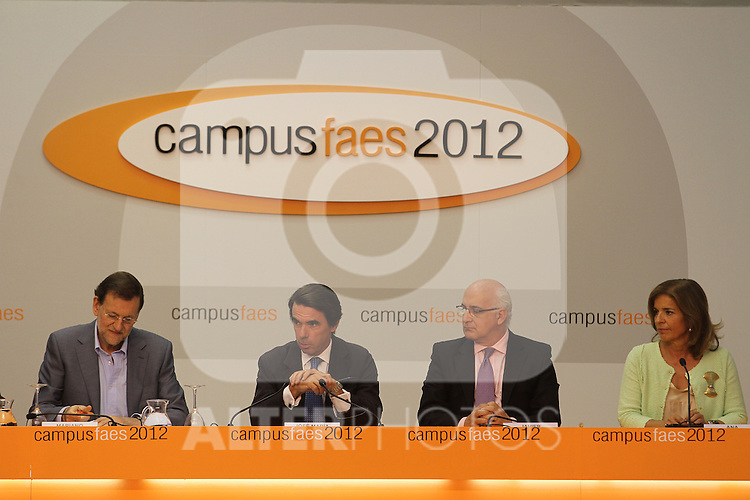 The Prime Minister of Spain, Mariano Rajoy (l), the President of FAES foundation (foundation for the analysis and social studies), José María Aznar (2-l) and the Mayores of Madrid City Ana Botella (r) have closed the ninth edition of Campus FAES, which took place in the town of Navacerrada, Madrid.July 7,2012. (ALTERPHOTOS/Alberto Simon)