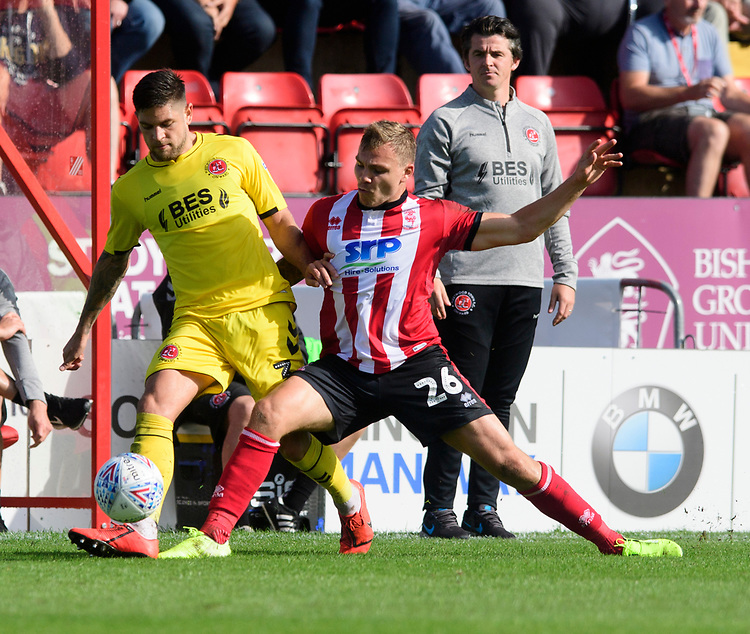Lincoln City's Harry Anderson vies for possession with Fleetwood Town's Danny Andrew<br /> <br /> Photographer Chris Vaughan/CameraSport<br /> <br /> The EFL Sky Bet League One - Lincoln City v Fleetwood Town - Saturday 31st August 2019 - Sincil Bank - Lincoln<br /> <br /> World Copyright © 2019 CameraSport. All rights reserved. 43 Linden Ave. Countesthorpe. Leicester. England. LE8 5PG - Tel: +44 (0) 116 277 4147 - admin@camerasport.com - www.camerasport.com