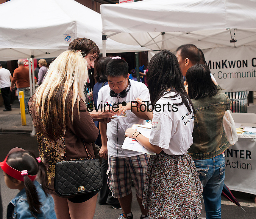 Voter registration at a street fair in Koreatown on West 32nd street in New York after the Korean Parade on Saturday, October 6, 2012. (© Richard B. Levine)