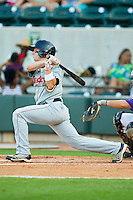 Tyler Holt #1 of the Kinston Indians follows through on his swing against the Winston-Salem Dash at BB&T Ballpark on June 4, 2011 in Winston-Salem, North Carolina.   Photo by Brian Westerholt / Four Seam Images