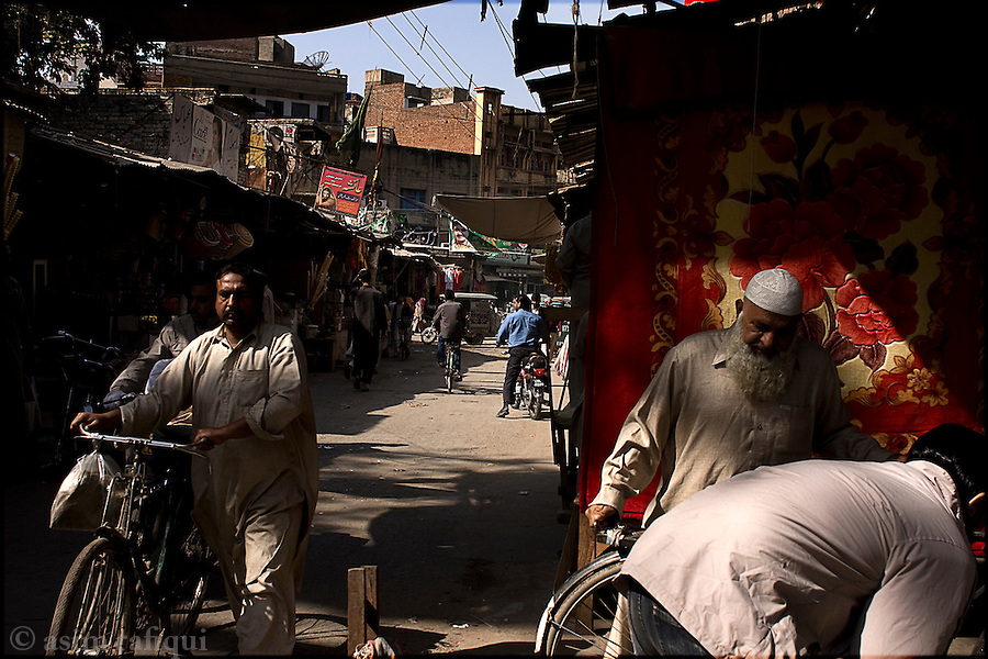 street scene in the bazaars of the old city of lahore