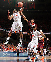 Virginia guard Justin Anderson (1) grabs a rebound in front of Virginia Tech guard/forward Marshall Wood (33) and Virginia forward Darion Atkins (32) during the game Saturday in Charlottesville, VA. Virginia won 65-45. Photo/The Daily Progress/Andrew Shurtleff