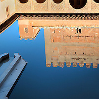 Reflection of a chamber and arched portico in the pond in the Court of the Myrtles, or Patio de los Arrayanes, built in the 14th century under Yusuf I, in the Comares Palace, Alhambra Palace, Granada, Andalusia, Southern Spain. The Alhambra was begun in the 11th century as a castle, and in the 13th and 14th centuries served as the royal palace of the Nasrid sultans. The huge complex contains the Alcazaba, Nasrid palaces, gardens and Generalife. Picture by Manuel Cohen