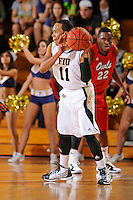 21 January 2012:  FIU guard Phil Taylor (11) handles the ball in the first half as the Florida Atlantic University Owls defeated the FIU Golden Panthers, 66-64, at the U.S. Century Bank Arena in Miami, Florida.