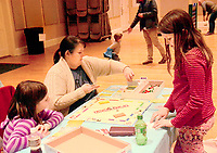 Janelle Jessen/Herald-Leader<br /> Michaela, Camille and Ruthie Wheeler played a game of Monopoly.