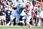 24 November 2012: UNC's Giovani Bernard (26) holds the facemask of Maryland's Jeremiah Johnson (14) while holding him off. The University of North Carolina Tar Heels played the University of Maryland Terrapins at Kenan Memorial Stadium in Chapel Hill, North Carolina in a 2012 NCAA Division I Football game. UNC won 45-38.