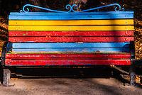 Russia, Sakhalin, Yuzhno-Sakhalinsk. Colourful bench in the Gagarin Park.