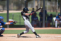 Chicago White Sox outfielder Tyler Frost (7) swings at a pitch in front of catcher Chase Vallot (3) during an Instructional League game against the Kansas City Royals at Camelback Ranch on September 25, 2018 in Glendale, Arizona. (Zachary Lucy/Four Seam Images)