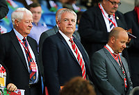 First Minister for Wales Carwyn Jones (C) watches the game during the FIFA World Cup Qualifier Group D match between Wales and Austria at The Cardiff City Stadium, Cardiff, Wales, UK. Saturday 02 September 2017