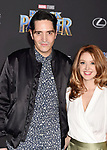 HOLLYWOOD, CA - JANUARY 29: Actors David Dastmalchian (L) and Evelyn Leigh attend the premiere of Disney and Marvel's 'Black Panther' at  the Dolby Theater on January 28, 2018 in Hollywood, California.