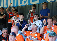 Blackpool fans enjoy the atmosphere inside of Glanford Park<br /> <br /> Photographer David Shipman/CameraSport<br /> <br /> The EFL Sky Bet League One - Scunthorpe United v Blackpool - Friday 19th April 2019 - Glanford Park - Scunthorpe<br /> <br /> World Copyright © 2019 CameraSport. All rights reserved. 43 Linden Ave. Countesthorpe. Leicester. England. LE8 5PG - Tel: +44 (0) 116 277 4147 - admin@camerasport.com - www.camerasport.com