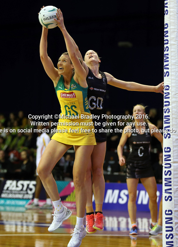 12.10.2016 Silver Ferns Katrina Grant and Australia's Caitlin Bassett in action during the Silver Ferns v Australia netball test match played at the Silver Dome in Launceston in Australia.. Mandatory Photo Credit ©Michael Bradley.