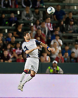 CARSON, CA – APRIL 30, 2011: New England Revolution defender Franco Cora (2) head the ball during the match between Chivas USA and New England Revolution at the Home Depot Center, April 30, 2011 in Carson, California. Final score Chivas USA 3, New England Revolution 0.