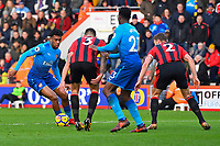 Alex Iwobi of Arsenal left taunts the AFC Bournemouth defence during AFC Bournemouth vs Arsenal, Premier League Football at the Vitality Stadium on 14th January 2018