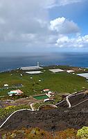 Rain clouds over the sea, lighthouse and banana plantation volcanic area.Fuencaliente, La Palma, Canary Islands.