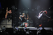 SUNRISE FL - DECEMBER 18: Calum Hood, Luke Hemmings, Ashton Irwin and Michael Clifford of 5 Seconds Of Summer perform at the Y100 Jingle Ball 2015 held at The BB&T Center on December 18, 2015 in Sunrise, Florida. (Photo by Larry Marano © 2015