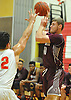 Josh Pismeny #10 of Deer Park, right, makes a pass during a Suffolk County varsity boys basketball game against host Half Hollow Hills West High School on Thursday, Jan. 19, 2017. Deer Park won by a score of 59-49.