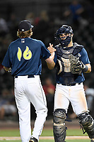 Pitcher Max Kuhns (16) of the Columbia Fireflies greets catcher Brandon Brosher after a game against the Lexington Legends on Thursday, June 8, 2017, at Spirit Communications Park in Columbia, South Carolina. Columbia won, 8-0. (Tom Priddy/Four Seam Images)