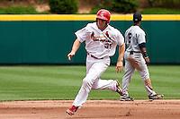 Kyle Conley (35) of the Springfield Cardinals rounds second base during a game against the Arkansas Travelers at Hammons Field on May 8, 2012 in Springfield, Missouri. (David Welker/ Four Seam Images)