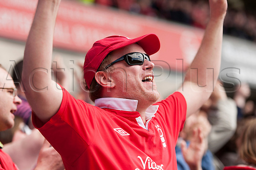 04.05.2013 Nottingham, England. Nottingham Forest supporter celebrates at Forest go one up during the Championship game between Nottingham Forest and Leicester City from the City Ground.