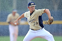 22 April 2012:  FIU pitcher Christian Malbrough (26) pitches as the rain begins to fall late in the game as the University of Arkansas Little Rock Trojans defeated the FIU Golden Panthers, 7-6, at University Park Stadium in Miami, Florida.
