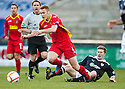 Pars' Ryan Thomson is brought down by Raith's Jason Thomson   ...