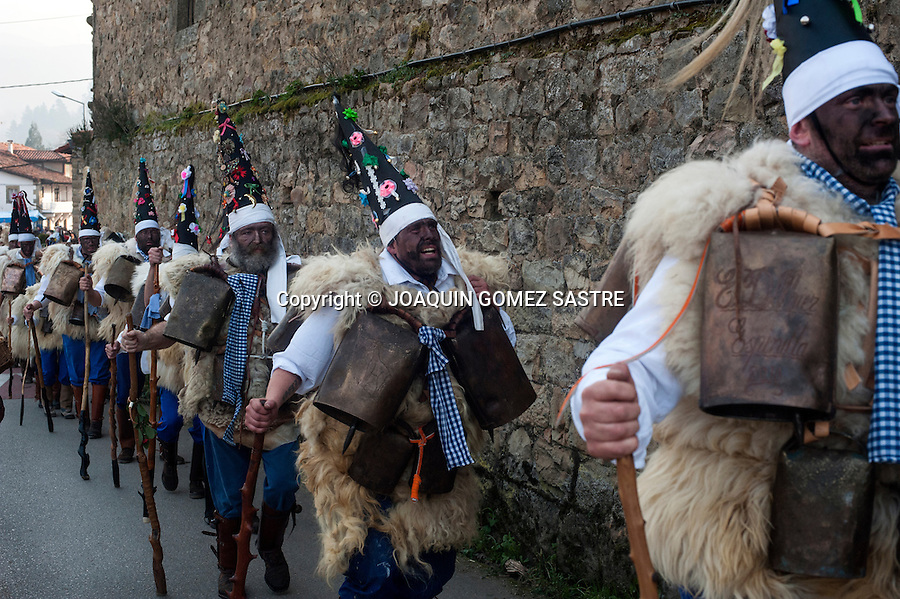 The zarramacos cross the streets of the town of Silio (Cantabria) in the party of the vijanera, considered the first winter carnival in Europe as they ring their bells to celebrate the capture of the bear that symbolizes evil.