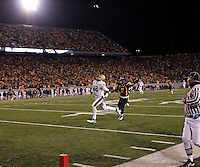 Pittsburgh wide receiver Jonathan Baldwin gets ready to make a 50-yard touchdown catch as WVU defensive back Sidney Glover (11) tries to catch up. The West Virginia Mountaineers defeated the Pittsburgh  Panthers 19-16 on November27, 2009 at Mountaineer Field at Milan Puskar Stadium, Morgantown, West Virginia.