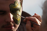 12/04/10-- Ian Applebaum,17, of Northeast Portland has a webfoot painted on his face by Ananda Reeves of Corvallis before the Civil War game at Reser Stadium in Corvallis, Or. Applebaum's brother-in-law Brandon Tett plays for the Ducks..Photo by Jaime Valdez......