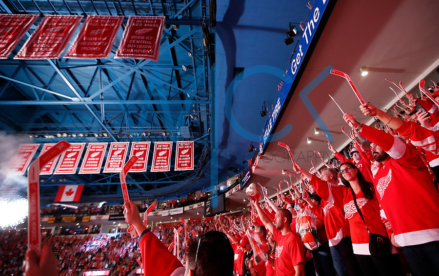 Detroit Red Wings fans raise their sticks during a post game presentation at Joe Louis Arena in Detroit, Michigan on Sunday April 9, 2017. (Photo by Jared Wickerham/The Players Tribune)