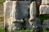 Close up of lower relief sculptures of Hittite gods at Eflatun Pınar ( Eflatunpınar) Ancient Hittite relief sculpture monument and sacred pool.  Between 15th to 13th centuries BC. Lake Beysehir National Park, Konya, Turkey.