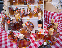 Decorative bottles of genuine New York State maple syrup for sale in the Union Square Greenmarket in New York on Monday, February 22, 2016. Maple syrup production shows sign of a banner year as the unseasonably warm winter has allowed the producers to tap their trees earlier. New York is the second-largest producer of maple syrup in the United States, second only to Vermont.  (© Richard B. Levine)