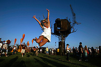 INDIO, CA - APRIL 25, 2008:  Juma La Faive, 22 , from Canada leaps into the air in front of the Steampunk treehouse on the opening day of the Coachella music festival.  This is the 9th annual Coachella Valley Music and Arts Festival in Indio. CA. held on April 25-27, 2008.