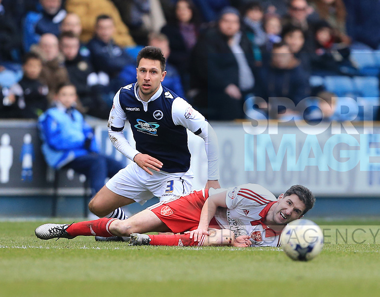 Millwall's Joe Martin tussles with Sheffield United's Chris Basham during the League One match at The Den.  Photo credit should read: David Klein/Sportimage