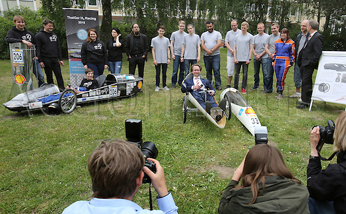 26.05.2016. London, England.  The two teams from Mecklenburg-Western Pomerania participating in the Shell Eco-marathon in London present themselves to State Minister of Education Mathias Brodkorb, who is sitting in the car from the University of Rostock in Rostock, 26 May 2016. To the left is the car from the team from the Fachhochschule Stralsund. The goal of the Shell Eco-marathon is to travel as far as possible with a liter of fuel or the respective energy equivalent. 300 teams from more than 28 countries are taking part this year.
