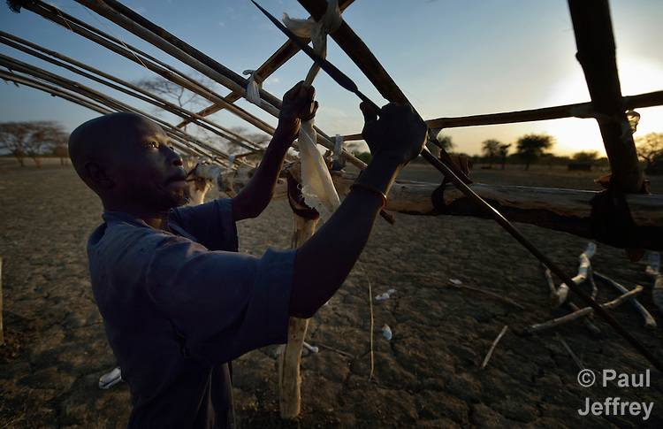 Akuei Lual fastens branches together to make a roof for his house in Abyei, a contested region along the border between Sudan and South Sudan. Under a 2005 peace agreement, the region was supposed to have a referendum to decide which country it would join, but the two countries have yet to agree on who can vote. In 2011, militias aligned with Khartoum drove out most of the Dinka Ngok residents, pushing them across a river into the town of Agok. Yet more than 40,000 Dinka Ngok have since returned with support from Caritas South Sudan, which has drilled wells, built houses, opened clinics and provided seeds and tools for the returnees.