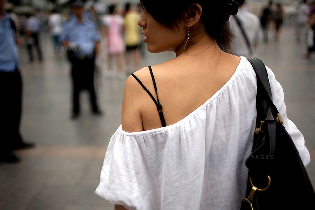 A Chinese woman walks in Tian'anmen Square in Beijing, China on Sunday, August 10, 2008.  Kevin German