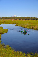 Kayaker, Williamson River on Timmerman Ranch, Mount Scott, Oregon.  June.