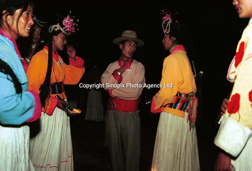 "Mosuo women at a ceremony known as the ""torch shining ceremony"" that takes place at the end of the fertility festival. During the ceremony women shine torches at potential mates. The Mosuo are one of the world's last matriachal societies. Women from the Mosuo tribe do not marry, take as many lovers as they wish and have no word for ""father"" or ""husband"". But the arrival of tourism and the sex industry is changing their culture...PHOTO BY SINOPIX"