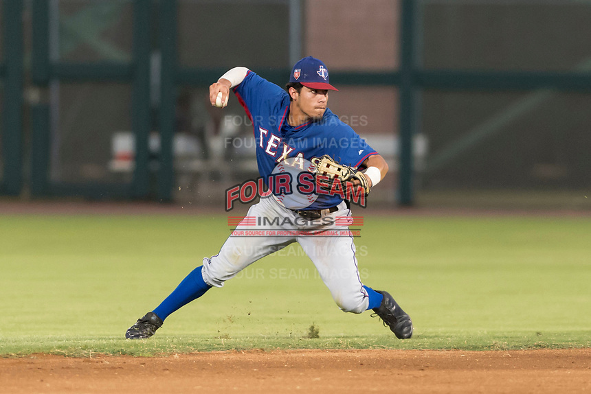 AZL Rangers shortstop Jonathan Ornelas (10) throws to first base during an Arizona League game against the AZL Giants Black at Scottsdale Stadium on August 4, 2018 in Scottsdale, Arizona. The AZL Giants Black defeated the AZL Rangers by a score of 6-3 in the second game of a doubleheader. (Zachary Lucy/Four Seam Images)