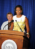United States First Lady Michelle Obama speaks at an event about the Affordable Care Act at George Washington University Hospital, on Wednesday, July 14, 2010, in Washington, DC.  Hospital employees also attended this event, including Inger Mobley, left, Clinical Manager of the Breast Care Center. .Credit: Leslie E. Kossoff - Pool via CNP