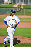 Michael Medina (25) of the Ogden Raptors runs off the field during the game against the Orem Owlz in Pioneer League action at Lindquist Field on June 18, 2015 in Ogden, Utah.  This was Opening Night play of the 2015 Pioneer League season. (Stephen Smith/Four Seam Images)