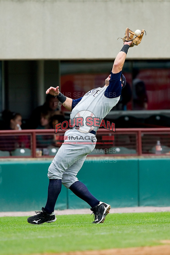 Third baseman Dallas McPherson #8 of the Charlotte Knights catches a foul pop fly against the Pawtucket Red Sox at McCoy Stadium on June 12, 2011 in Pawtucket, Rhode Island.  The Red Sox defeated the Knights 2-1.    Photo by Brian Westerholt / Four Seam Images