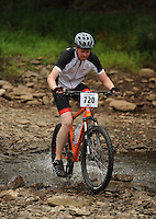 NWA Democrat-Gazette/ANDY SHUPE<br /> Jjoseph Hayes of Bentonville rides across Lee Creek Saturday, Sept. 19, 2015, during the Northwest Arkansas Mountain Bike Championships at Devil's Den State park.