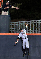 Virginia outfielder Derek Fisher (23) misses the home run ball from Arkansas outfielder Krisjon Wilkerson (33) over the left field wall in the seventh inning during an NCAA college baseball regional tournament game in Charlottesville, VA., Sunday, June 1, 2014. (Photo/Andrew Shurtleff)