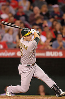 Oakland Athletics designated hitter Josh Willingham #16 bats against the Los Angeles Angels at Angel Stadium on September 24, 2011 in Anaheim,California. Los Angeles defeated Oakland 4-2.(Larry Goren/Four Seam Images)