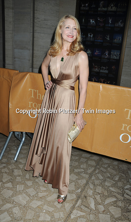 Patricia Clarkson posing for photographers at The Metropolitan Opera Fall 2010 Season Opening of Das Rheingold on September 27, 2010 at the Metropolitan Opera House in Lincoln Center in New York City.